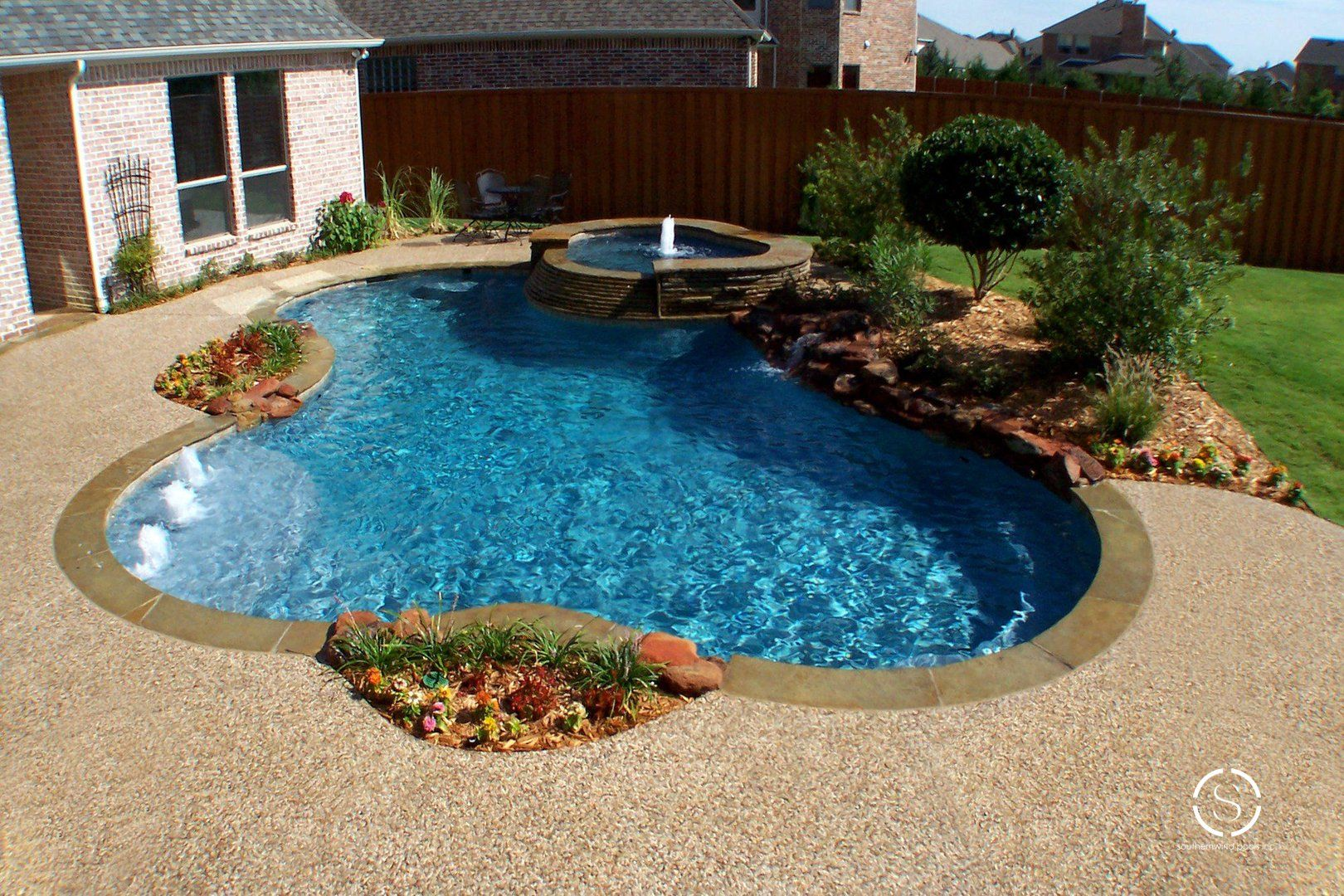 Sheer Descent waterfall from @zodiacpoolusa that we ... |Small Freeform Pools With Waterfalls