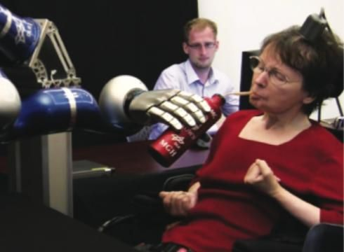 """""""Paralysis victims use brain signals to control robotic arm"""""""