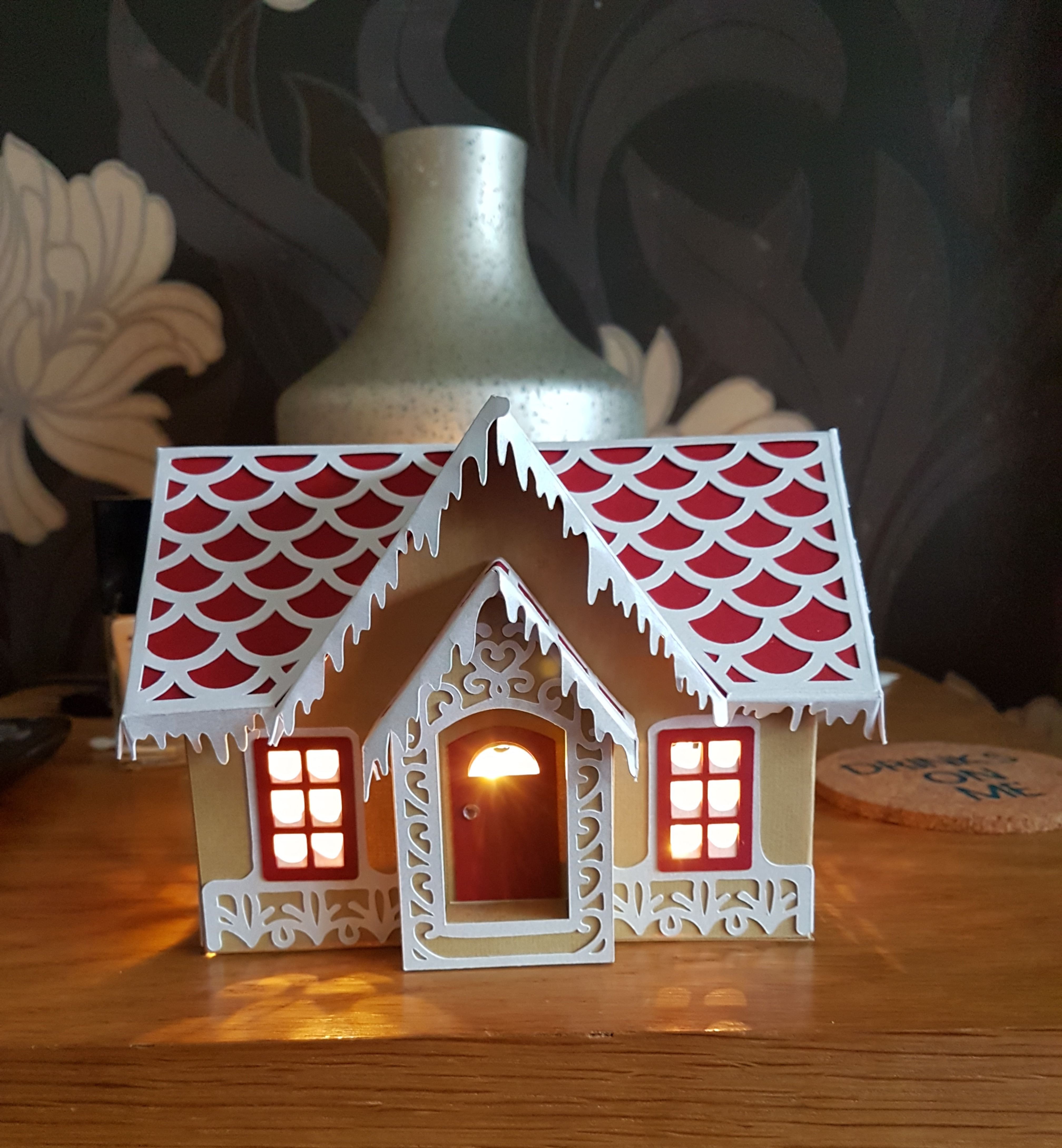Gingerbread house made with cricut maker and lights added