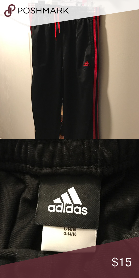 4e0b8a253dd8 Adidas boys track pants boys size L 14/16 Black and red three striped track  pants. Excellent condition. No signs of being worn. Adidas Bottoms  Sweatpants & ...