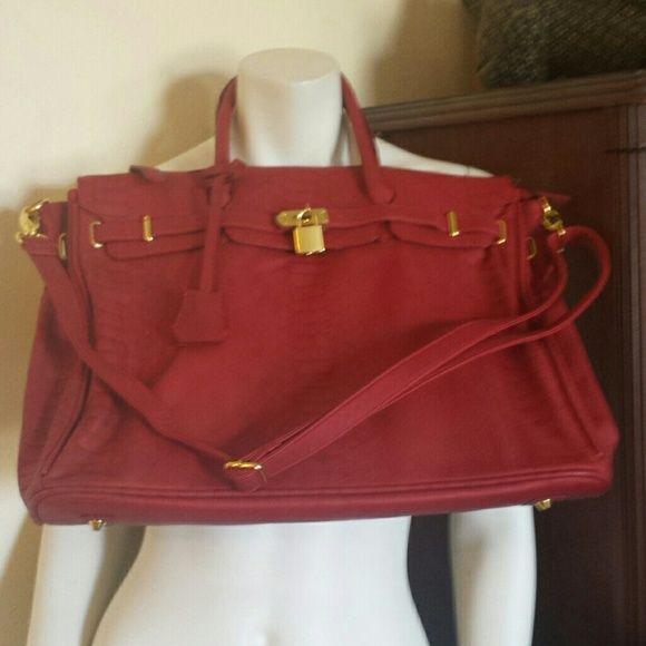 Deep red roomy tote Beautiful deep red large tote with snakeskin embossing.  Roomy and can be carried by the handles or worn as a cross-body.  Luxurious looking with minimal wear. Bags Totes