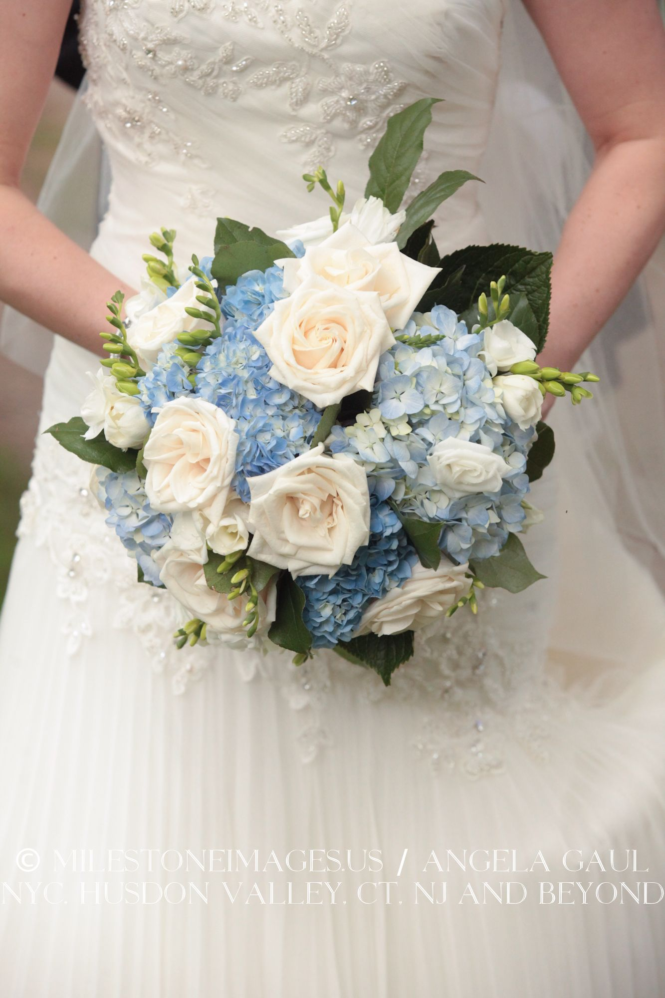 bridal bouquet made of white roses and blue hydrangeas ...