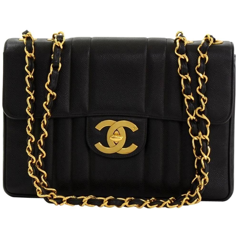 Chanel 12 Jumbo Black Vertical Quilted Caviar Leather Shoulder Flap Bag 1stdibs Com Bags Flap Bag Chanel Bag