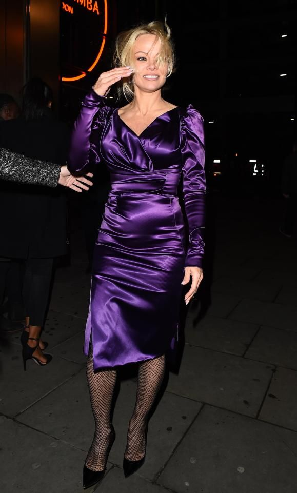 8a160bdc Pamela Anderson looks worse for wear as she flashes her legs in racy ...