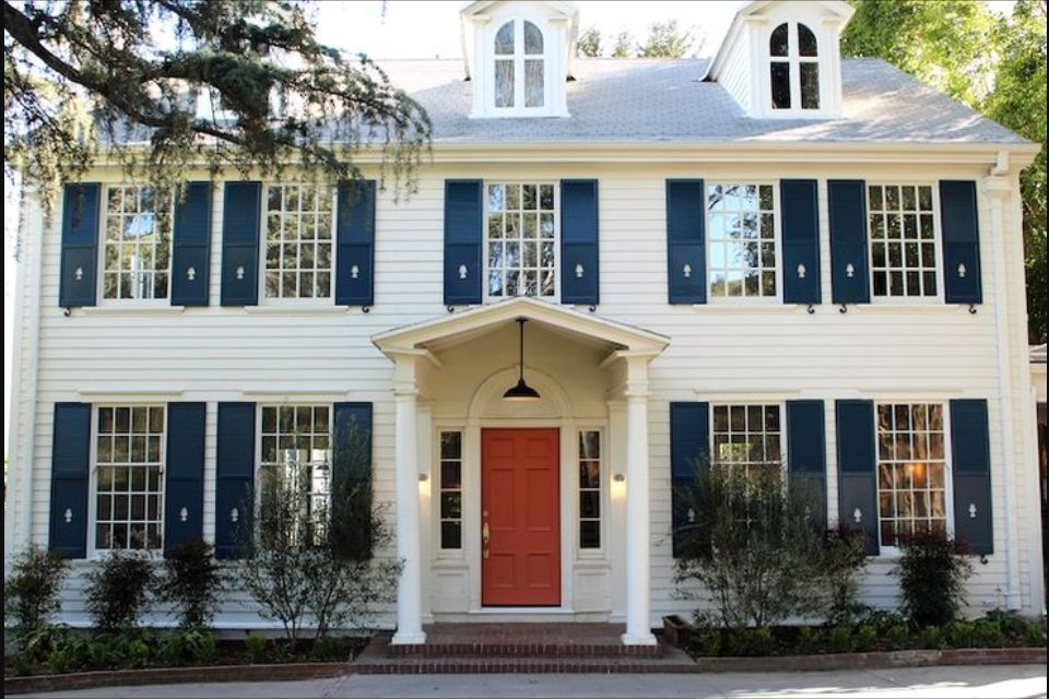 White Colonial With Navy Blue Shutters And Red Front Door Colonial House Exteriors House Shutters Traditional Home Exteriors