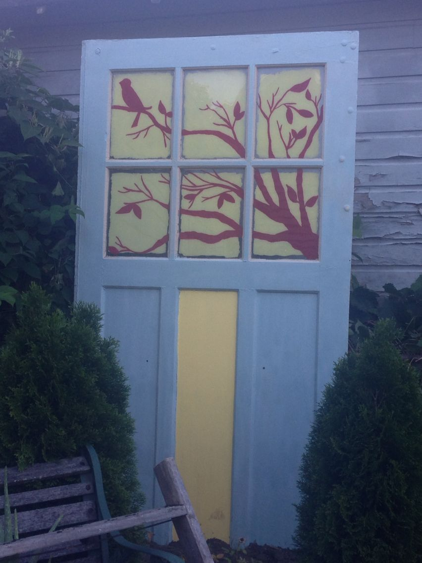 Old garage door i turned into yard art and fence part out of