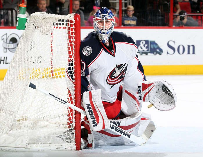 RALEIGH, NC - MARCH 30: Joonas Korpisalo #70 of the Columbus Blue Jackets guards the post as he watches a play develop during an NHL game against the Carolina Hurricanes on March 30, 2017 at PNC Arena in Raleigh, North Carolina. (Photo by Gregg Forwerck/NHLI via Getty Images)