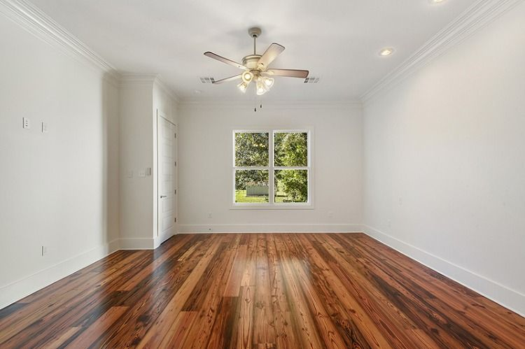 Beautiful Secondary Bedroom With Lighted Ceiling Fan Hardwood