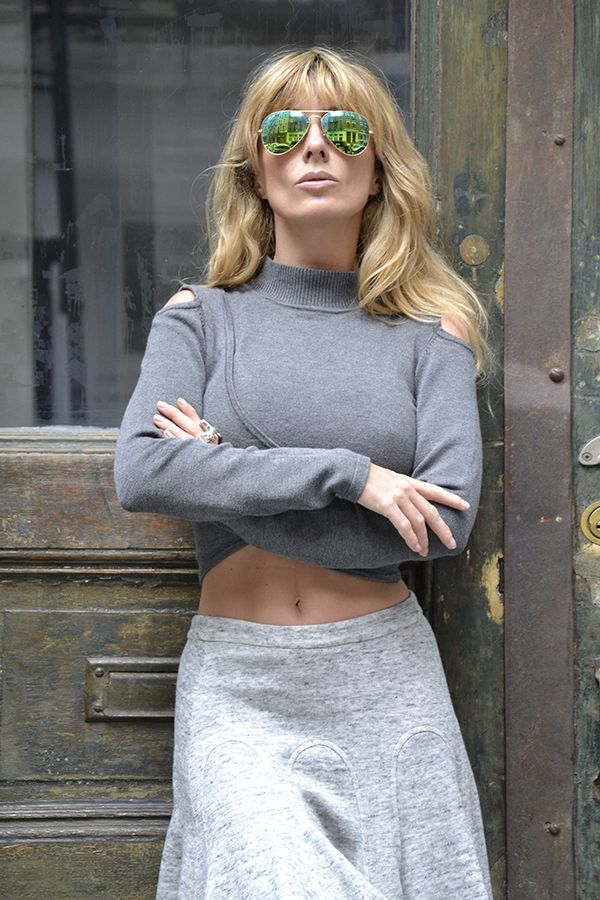 Jonathan Simkhai crop top crossover turtleneck outfit, Ray-Ban mirrored aviator sunglasses. Veryverve