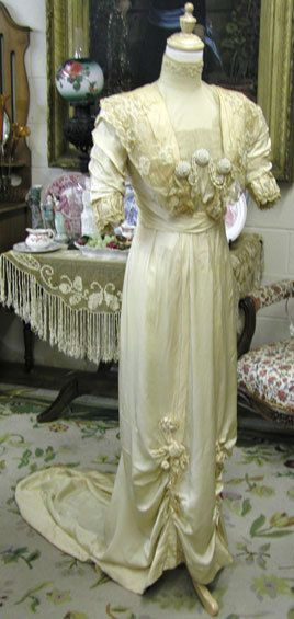 1908 extant gown; beautiful trims on bodice and bottom of skirt.