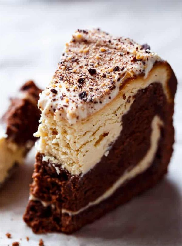 CHOCOLATE PEANUT BUTTER CHEESECAKE CAKE | Chocolate Peanut Butter Cheesecake Cake made in the ONE pan! Creamy peanut butter cheesecake bakes on top of a fudgy chocolate cake for the ultimate dessert! Another slice of decadence deserving of a drumroll just in time for the weekend. I give you Peanut Butter Cheesecake / Chocolate Cake.... #Butter, #Cake, #Cheesecake, #Chocolate, #Dessert, #Milk, #Peanut, #Recipes