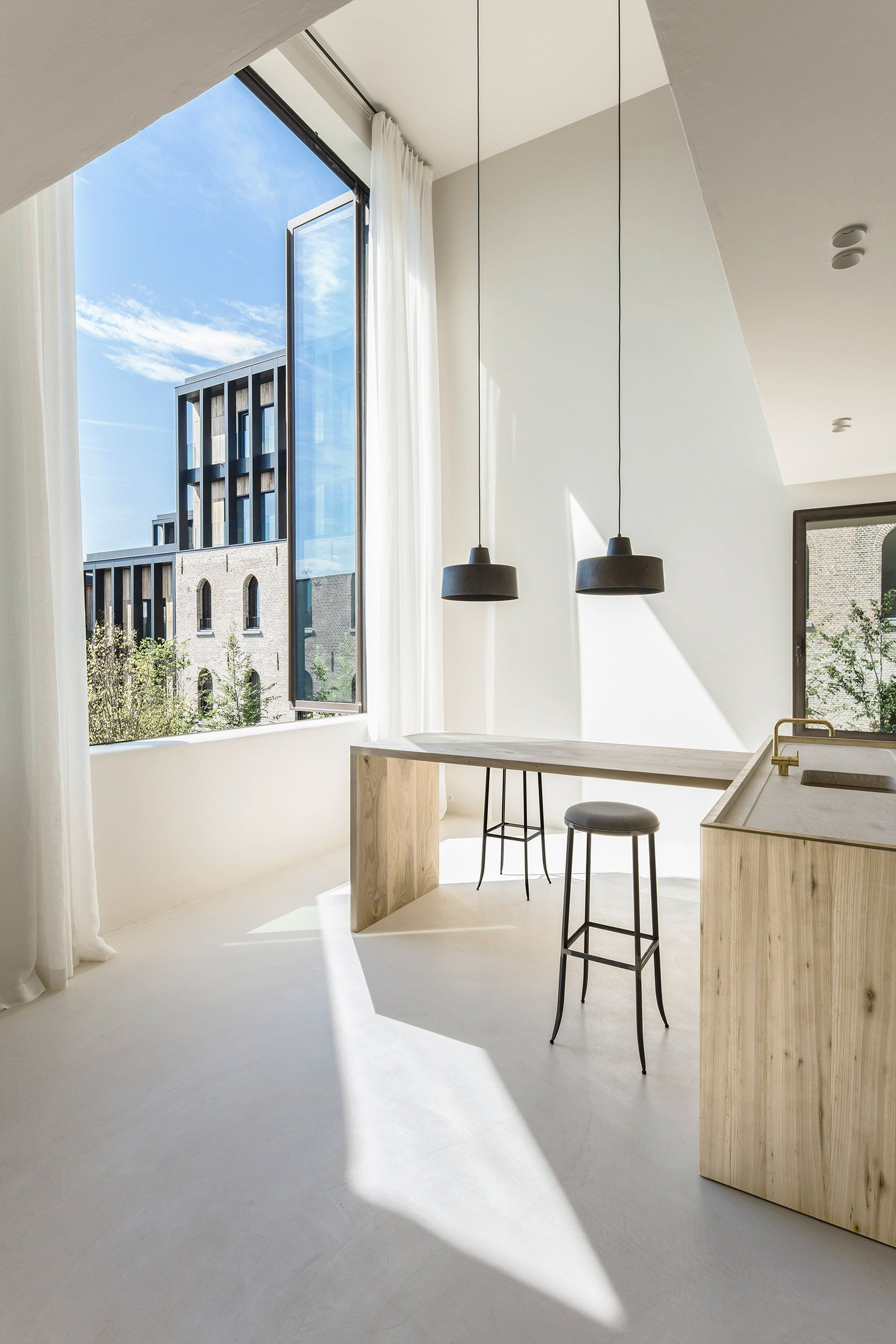 The apartment designed by interior architect Arjaan De Feyter is ...