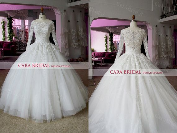 The classic wedding dress. This would be perfect for a winter wedding.Lace  Tulle Ball Gown with Long Sleeve Bateau by CaraBridal, $299.00