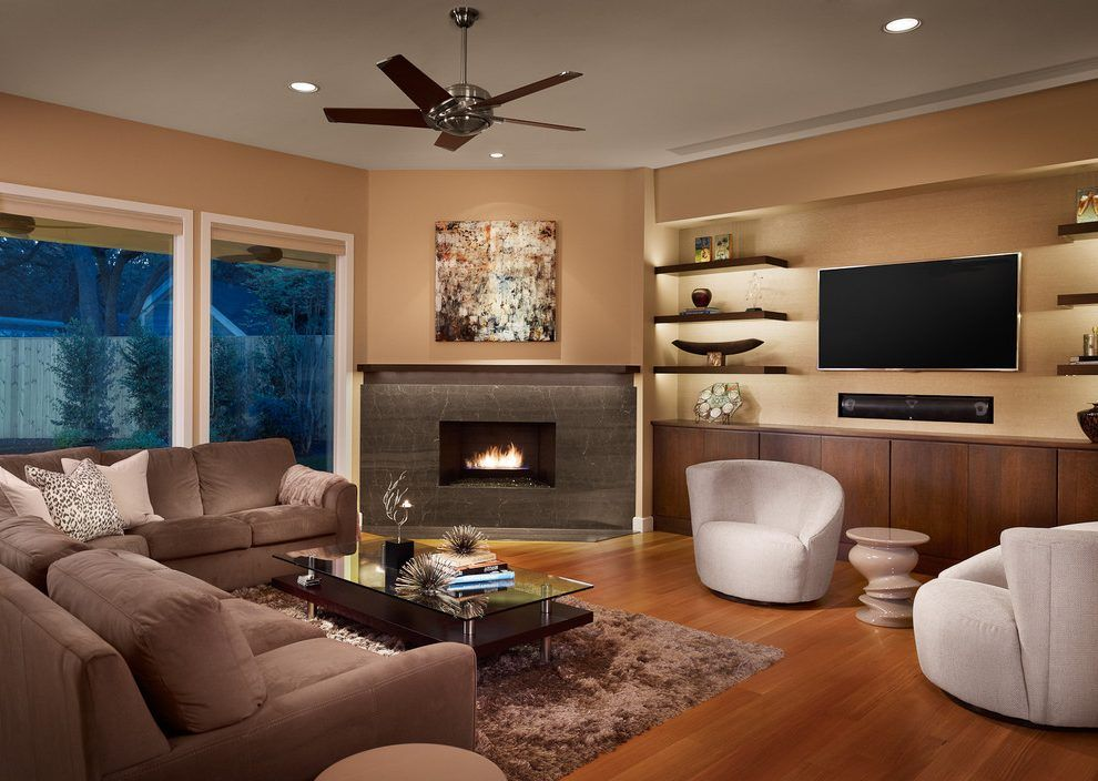 Floating shelves next to fireplace family room for Next living room designs