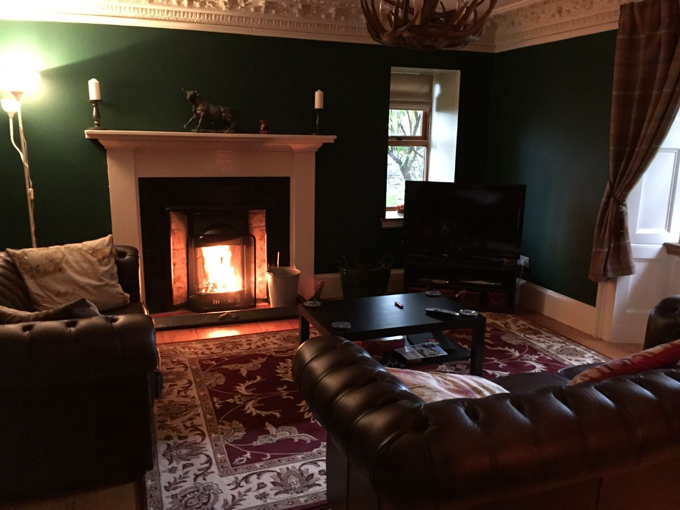 scottish country lounge with roaring fire chesterfield sofas