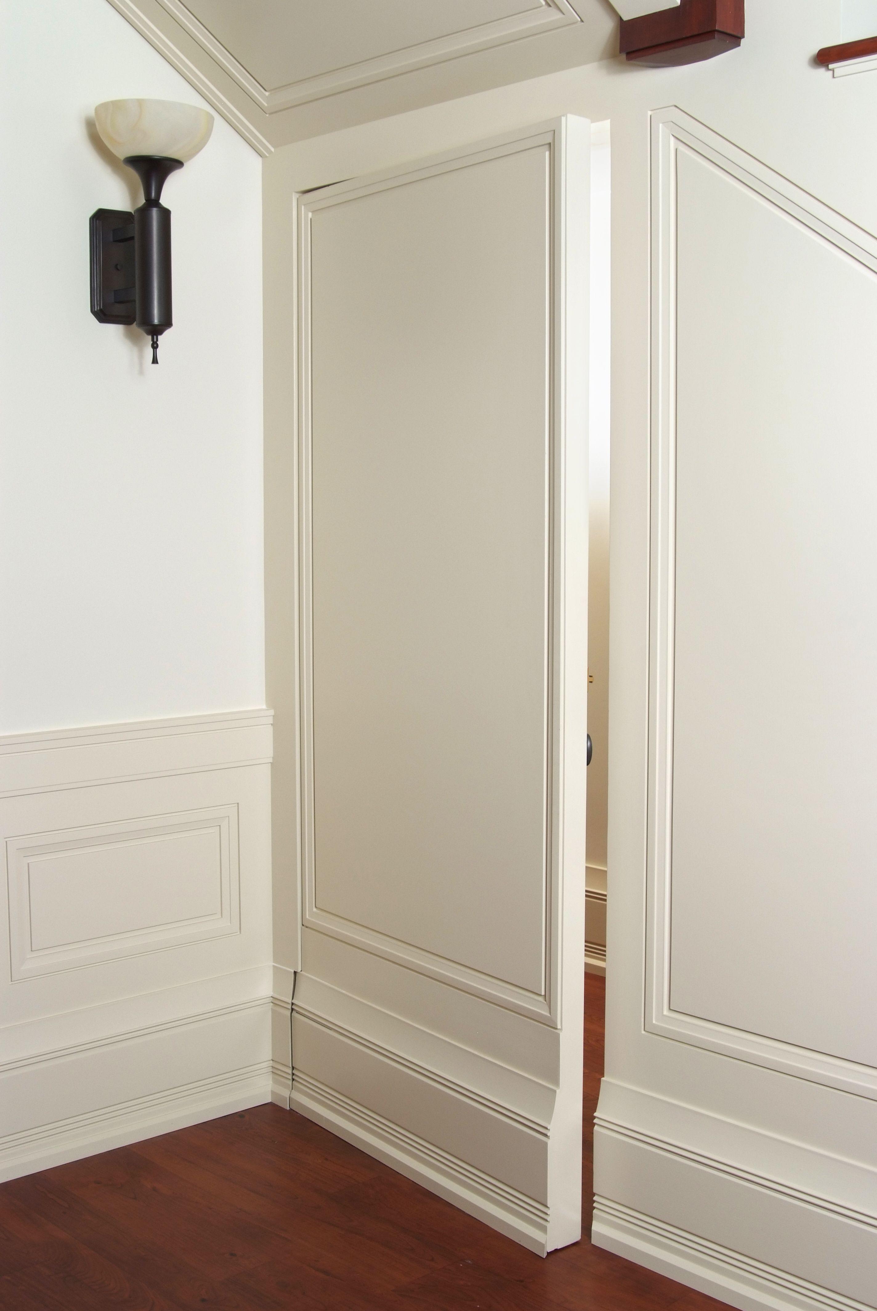 Secret paneled door with custom baseboard and shoe