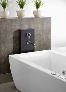 Wood Column Supports Wall Mount Faucet For A Freestanding Bath
