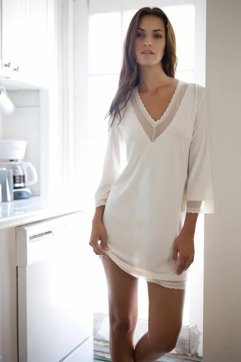 5aabad94d614 The Gisele Tunic is great for sleeping or slipping over your bikini on the  way to the beach! In store now in both black and white