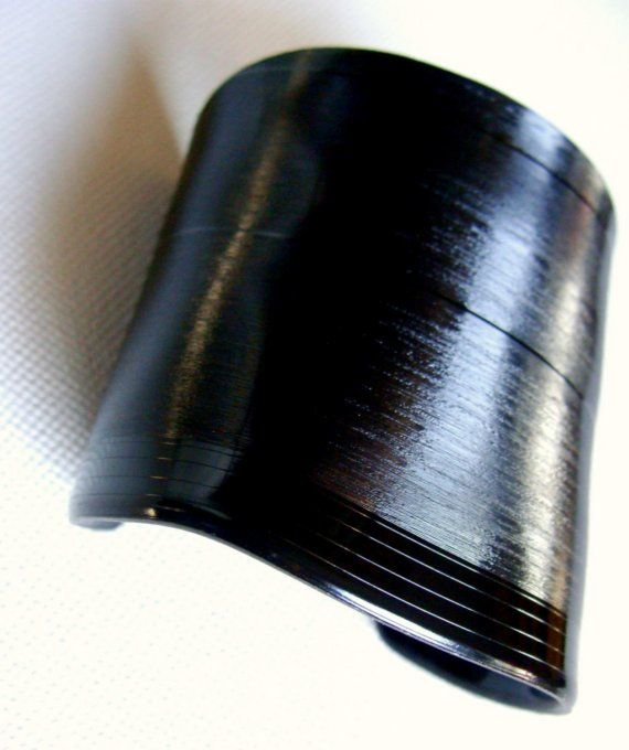A bracelet/cuff made from a vinyl record.  My husband would NEVER let me do that to one of his albums.