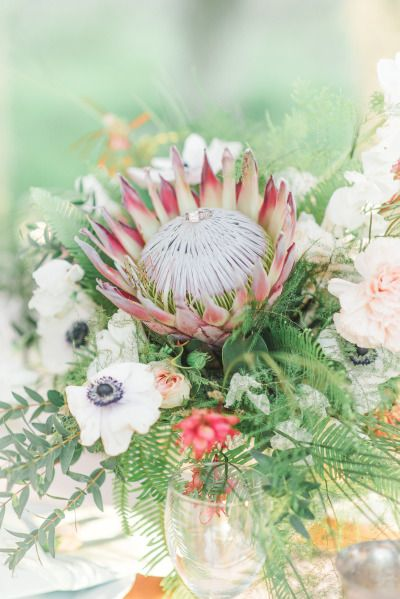 Protea centerpiece: http://www.stylemepretty.com/texas-weddings/richmond-tx/2015/05/01/whimsical-southern-spanish-moss-wedding-inspiration/ | Photography: Mallory Gilani - http://www.mallorygilani.com/