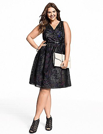 Truly unique with fashion cred to wow at any occasion, our perforated dress gets a modern new outlook with a floral print lining. Flattering surplice neckline flares into a playful knee-length skirt, with a skinny belt to define the waist. Sheer straps. Hidden side zipper with hook & eye closure. lanebryant.com