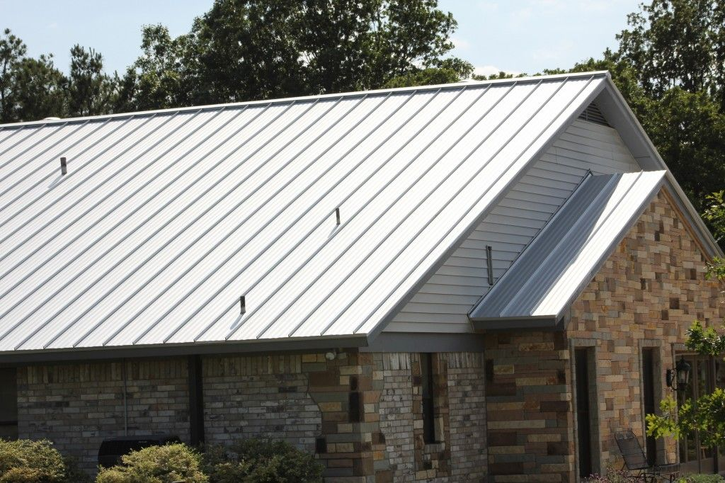 Metal roof metal roof flashing details modern brick for Modern metal roof
