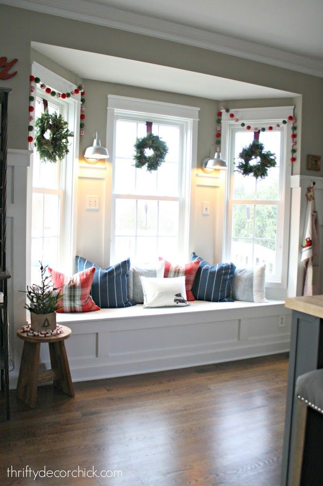 Bay window seat in kitchen decorated for christmas for What furniture to put in a bay window