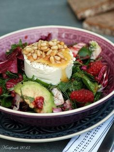 Photo of Summer salad with raspberries, avocado and goat cheese