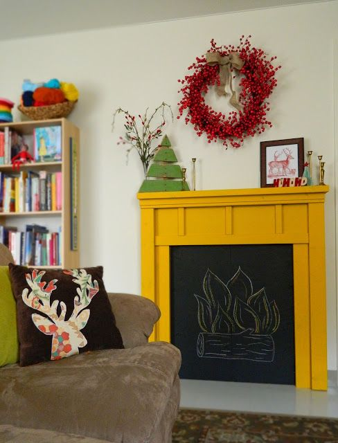 This faux fireplace with chalkboard paint would be so cute in a ...