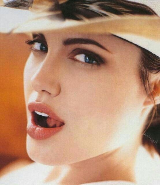 Photo of See new instagram released photos of Angelina Jolie Look Alike who had 50 Surgeries to look l…