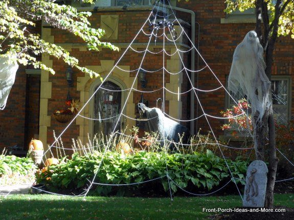 awesome spider web on this halloween front porch and there are more ideas at www front porch ideas and more com halloween decorating outdoor ideas html