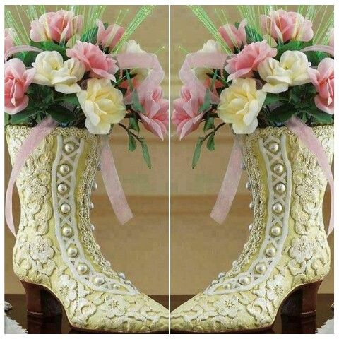 Patterned boots with white pearls and pink ribbons hold these amazing flowers. Birthday for Mary G.
