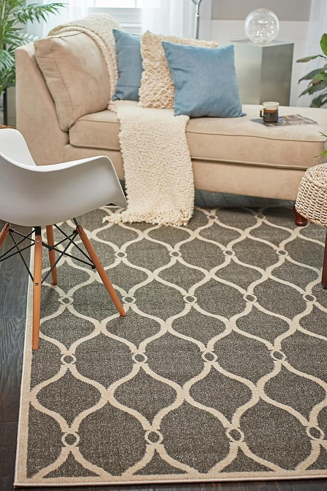 "This Turkish Trellis rug is made of Polypropylene. This rug is easy-to-clean, stain resistant, and does not shed. Colors found in this rug include: Gray, Cream. The primary color is Gray. This rug is 1/2"" thick."