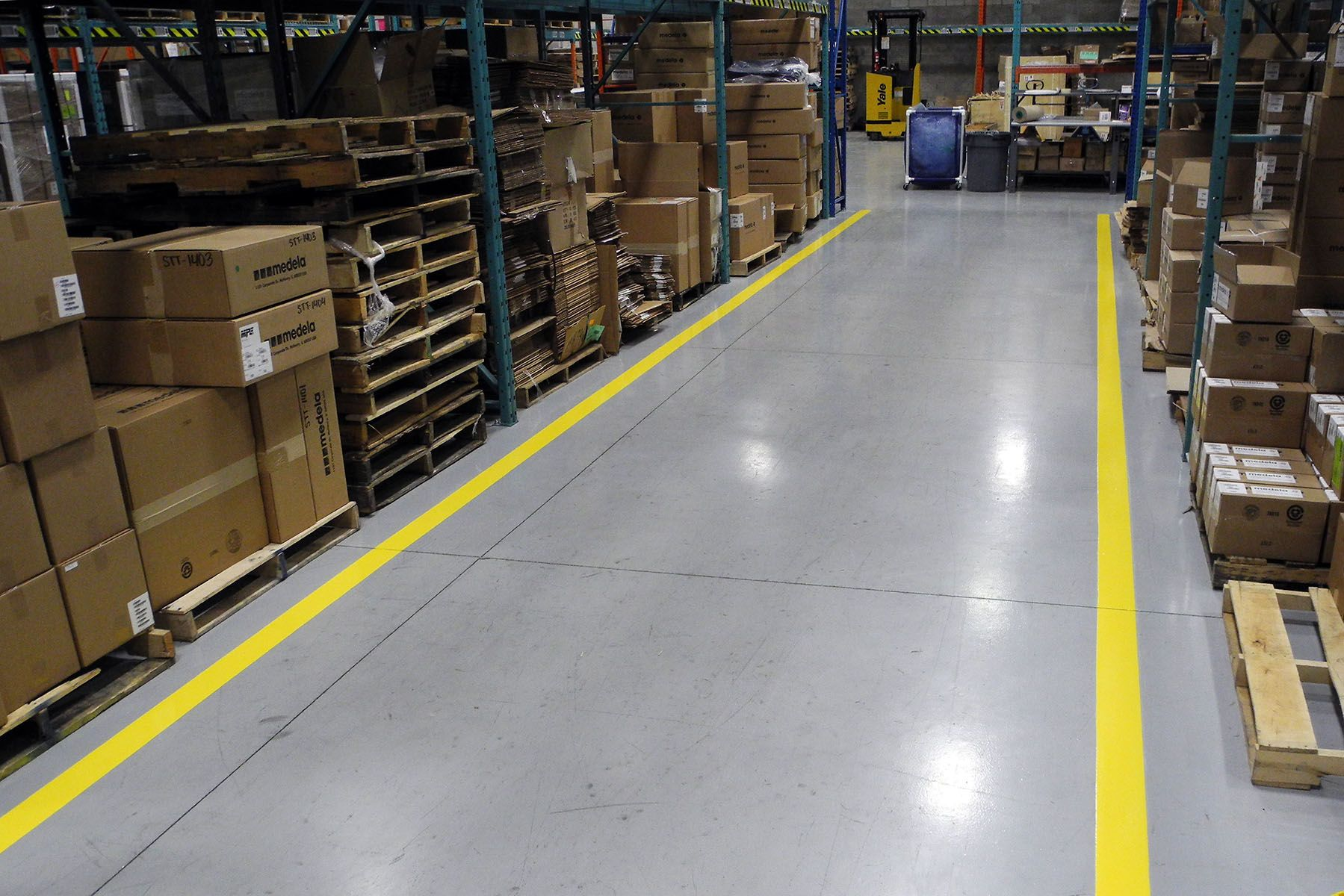 Grey Epoxy Flooring In One Area And Installation Of Yellow