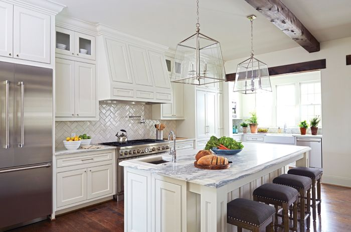 White Kitchen Herringbone Backsplash white cabinets, marble counters, exposed beam. #kitchen