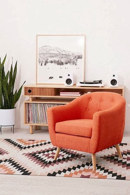 Subtle button tufting and a classic club design give this arm chair a retro feel that's equally at home in modern spaces. Let it round out a retro seating group in the den, or top it with a patterned pillow for a stylish finishing touch in the study.