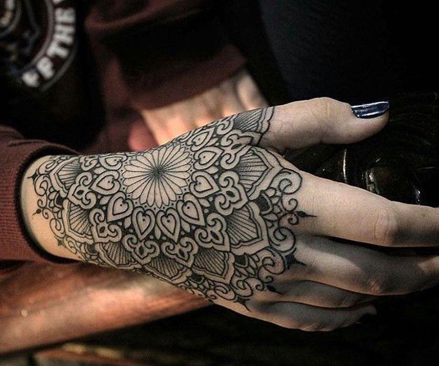Tattoo on the hand of the girl the mandala Mandala