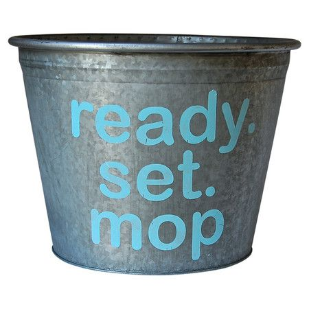 Stow hand towels in your master bath or cleaning supplies in the laundry room with this charming metal storage bucket, showcasing a rustic-chic galvanized fi...