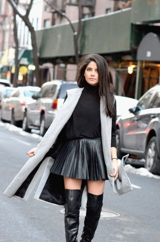 Fashion · Lovely shiny skirt with a nice pair of thigh length boots.