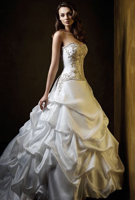 This dress is a timeless, strapless ballgown. The body of the dress is fitted and has beautiful beading. I purchased it new from Alfred Angelo but never got married. This dress is brand new and still wrapped. It's a gorgeous dress and will make you look like a princess.
