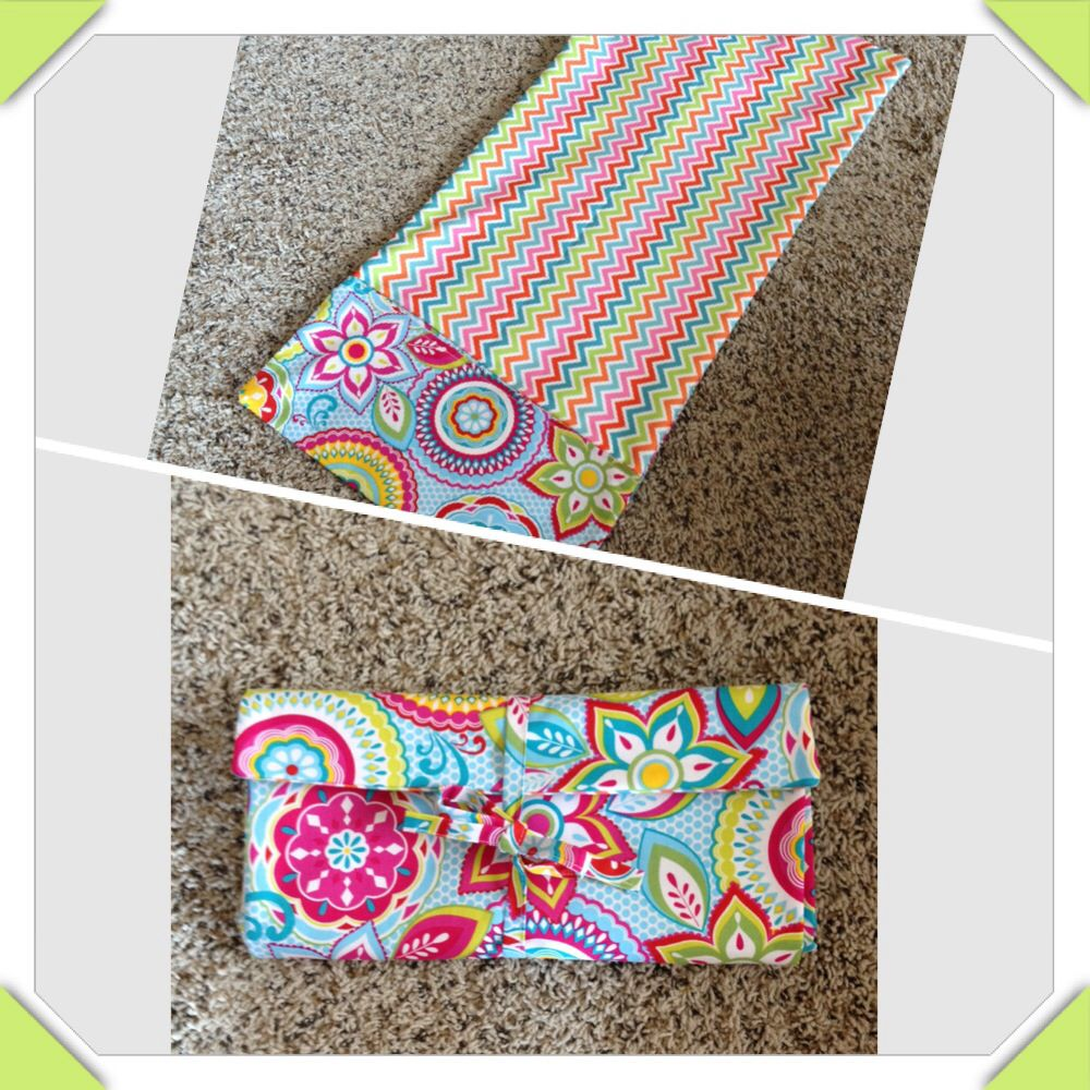 Travel Changing Pad Tutorial with pocket for diapers/wipes and waterproof lining. Folds up for easy storage in diaper bag. I added tie on the outside fabric rather than the button and elastic in the tutorial.