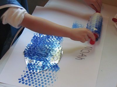 bubble wrap wrapped around rolling pin for printing. Awesome!! Activity of foil fish interesting too.