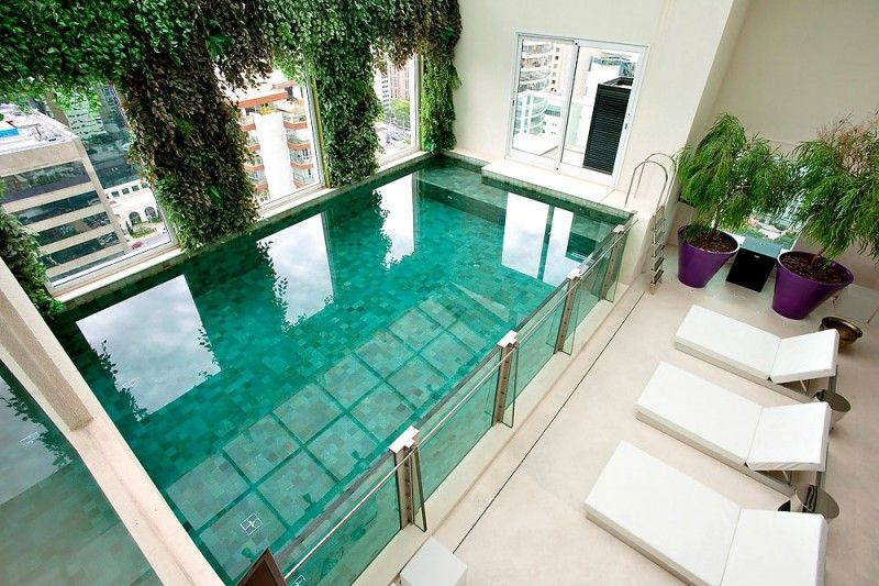 Malibu Duplex Apartment by Fernanda Marques Arquitetos Associados. amazing indoor pool.