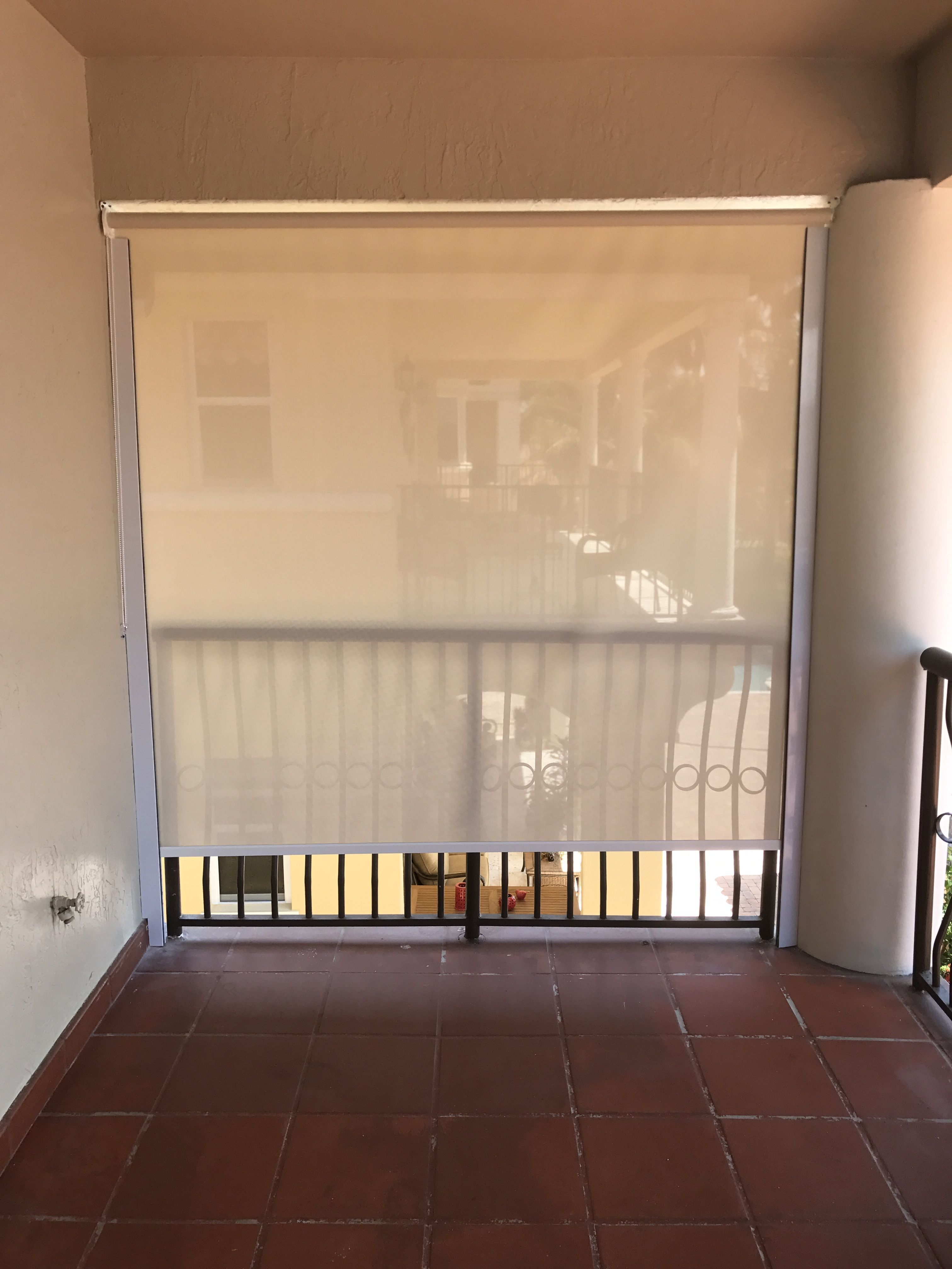 Outdoor ivorywhite screen roller shade with guided side rails by