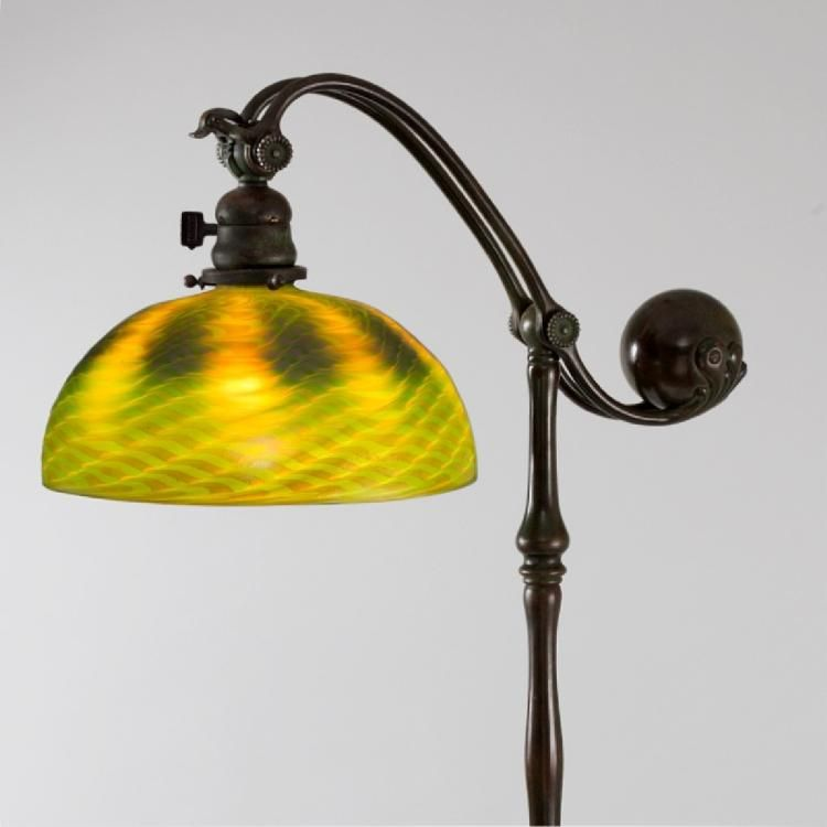 A Tiffany Studios New York Counterbalance Floor Lamp With An Iridescent Green Favrile Glass Damascene Shade Featuring A Wave Pattern And Five Footed Lampade