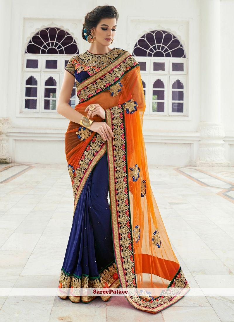 e449469224 Superb Navy Blue and Orange Patch Border Work Net Designer Saree in ...