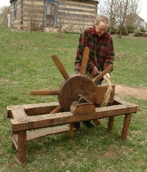Flax Process - Christian demonstrates the scutching wheel, a high-tech version of the single, hand-held scutching knife invented in Scotland in the mid-eighteenth century. Its eight blades are put into a revolving wheel powered with a foot treadle. Such wheels were typically owned by professional flax dressers who, like modern combine operators in the Mid West, went farm to farm processing flax for a fee. http://flaxforsale.com/html/flax_process.html