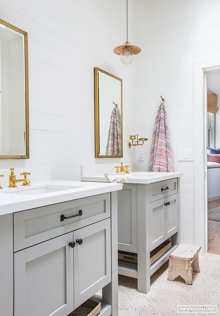 Double Light Grey Vanities In Bathroom With Gold Hardware