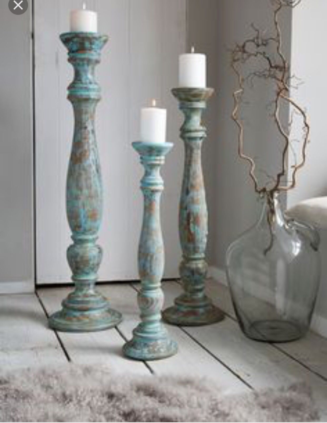 Window well decoration ideas  trio rustic turned wood  tall floor pillar candle holdersstands