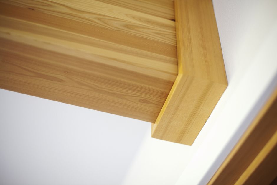 Finish craftsmanship exposed glulam beam wrapped in cedar
